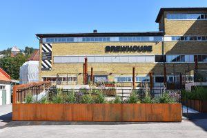 Utsidan av den gula tegelbyggnaden Brewhouse.