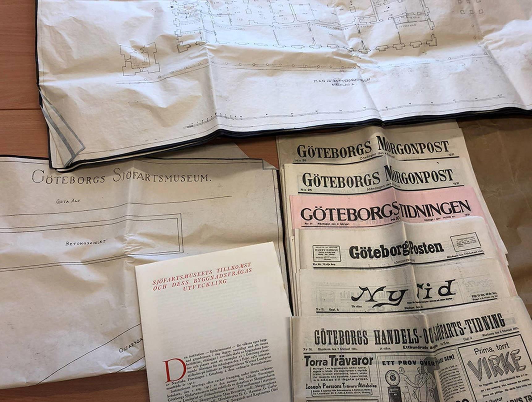 Gamla tidningar, en skrift och ritningar