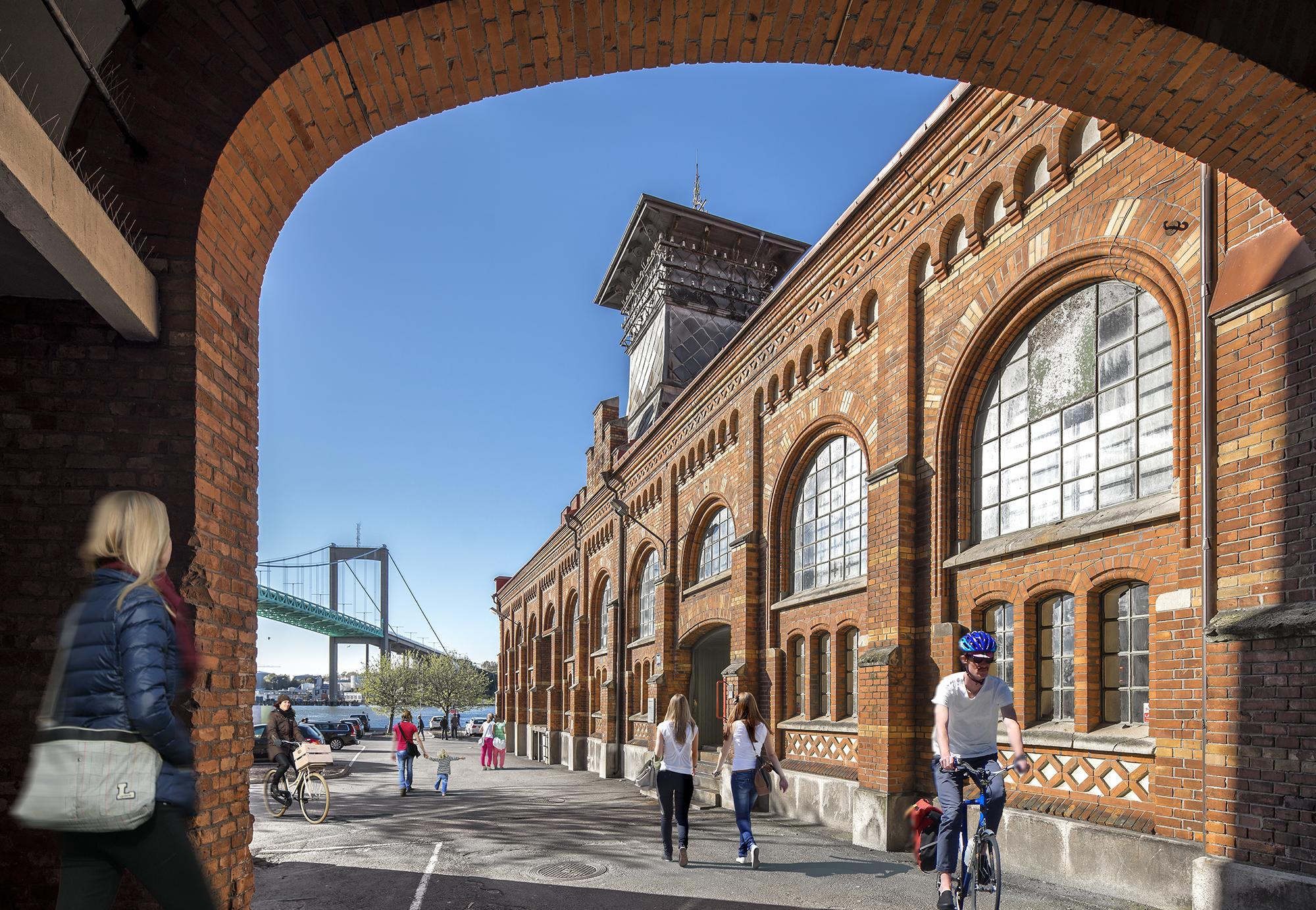 Bild tagen genom valv där en av Sockerbrukets byggnader och Älvsborgsbron syns